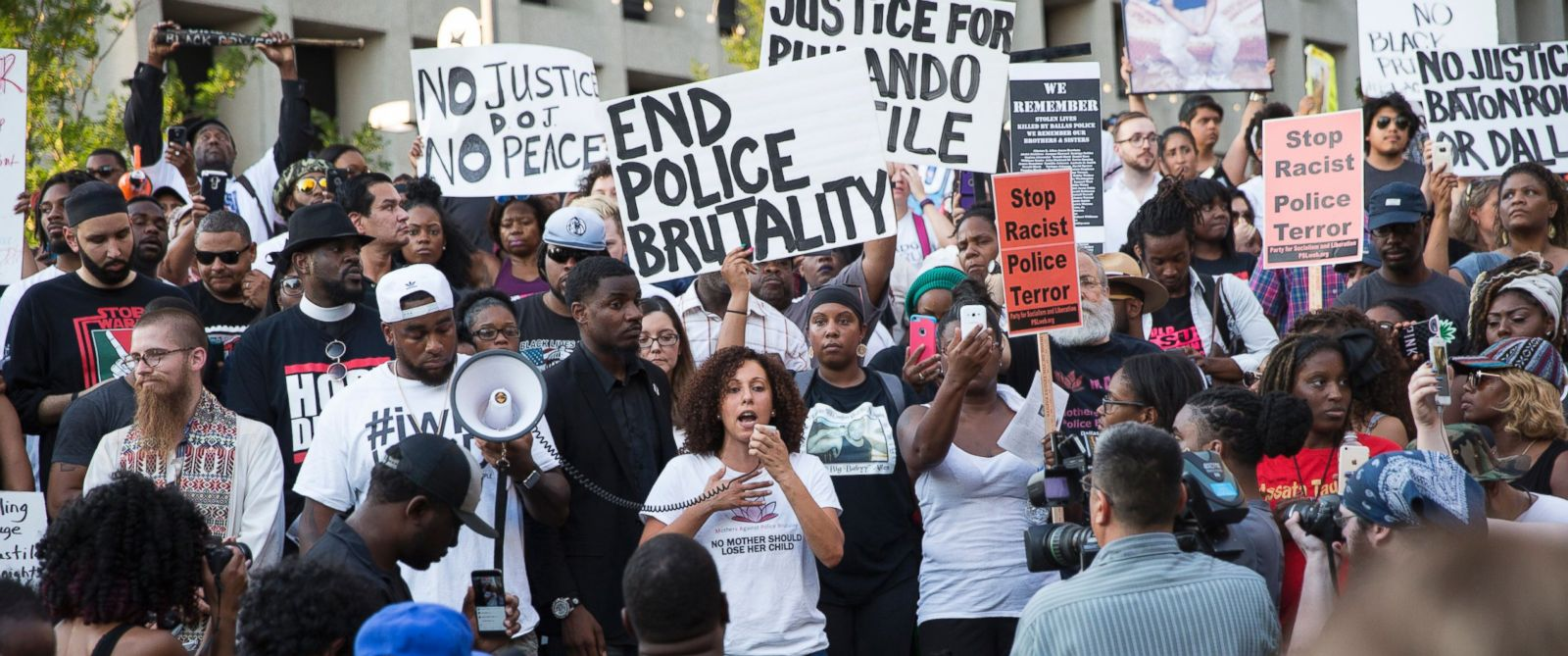 PHOTO: People rally in Dallas, July 7, 2016 to protest the deaths of Alton Sterling and Philando Castile.