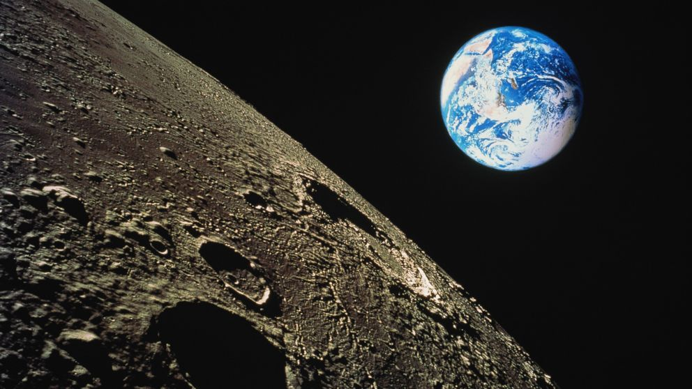 PHOTO: The moons surface is shown with the earth in background in this composite photograph.