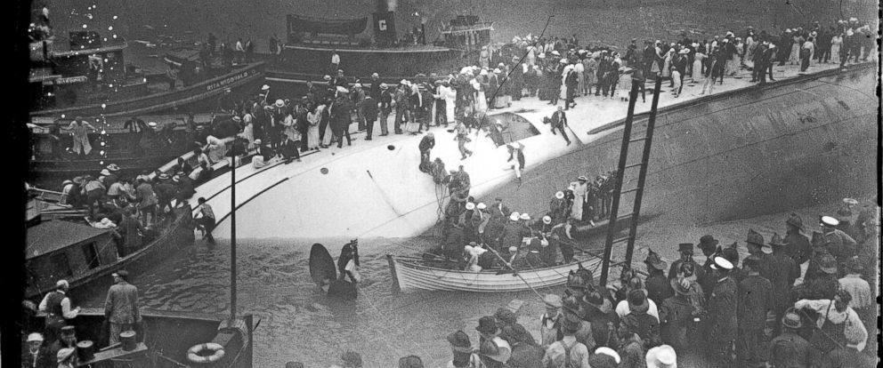 PHOTO: Survivors standing on the hull of the overturned Eastland steamer in Chicago, July 24, 1915.