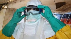 PHOTO: Doctors Without Borders put on protective gear at the isolation ward of the Donka Hospital in Conakry, Guinea, June 28, 2014.