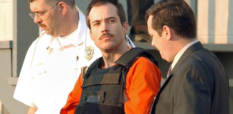 PHOTO: Multiple bombing suspect Eric Robert Rudolph is escorted by law enforcement officials from the Cherokee County Courthouse and Jail in Murphy, N.C, June 2, 2003, to a Federal court hearing in Asheville, N.C.