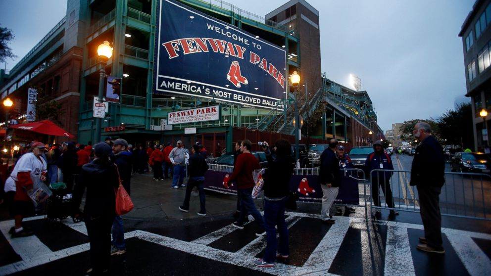 PHOTO: Fans walk outside Fenway Park