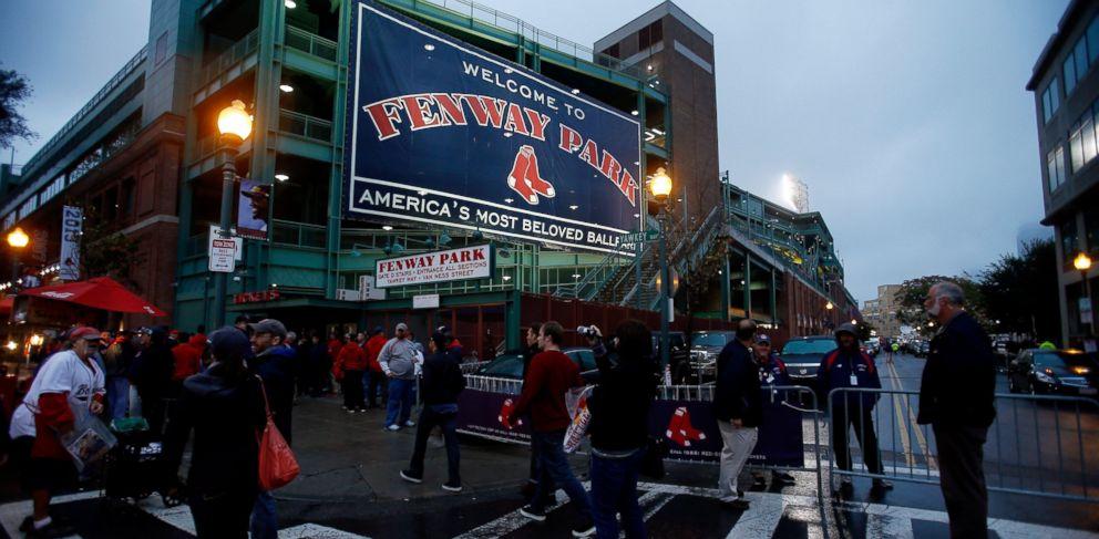 PHOTO: Fans walk outside Fenway Park