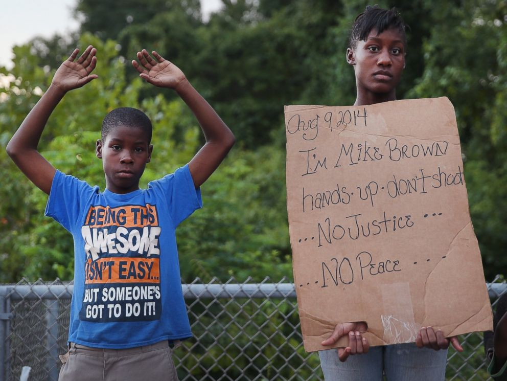 PHOTO: Leo Walker, left, and his sister Letrece, right, protest the killing of Michael Brown on Aug. 17, 2014 in Ferguson, Mo.