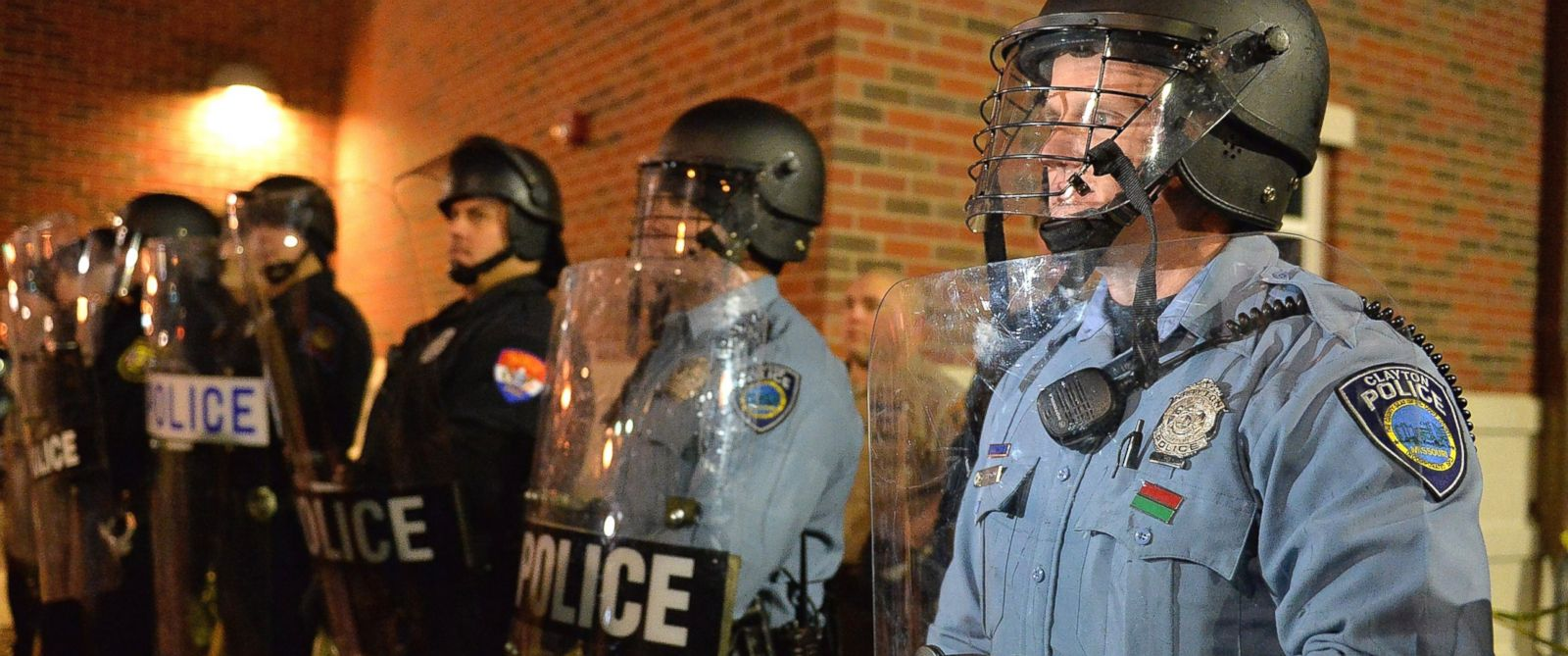PHOTO: Police officers stand in riot gear during a protest, Nov. 19, 2014 outside the Ferguson Police Department in Ferguson, Mo.
