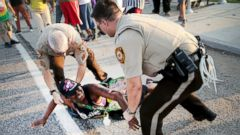 PHOTO: A demonstrator is arrested while protesting the killing of teenager Michael Brown, Aug. 19, 2014, in Ferguson, Missouri.