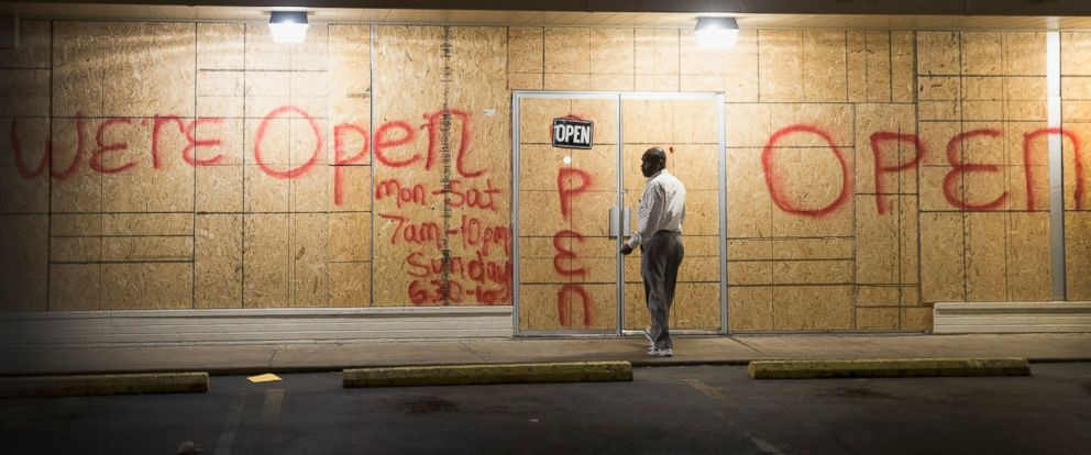 PHOTO: Plywood covers the glass front of a strip mall along West Florissant Street on Nov. 12, 2014 in Ferguson, Mo.