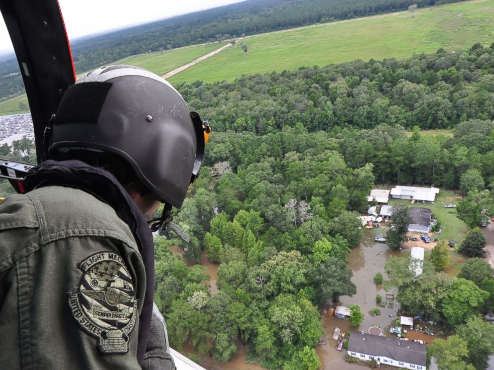 PHOTO: A Coast Guard crew searches by helicopter for people who may need assistance in flooded areas of Baton Rouge, Louisiana, Aug. 15, 2016.