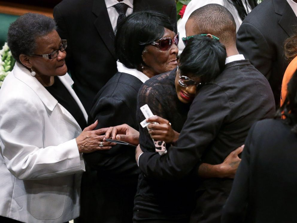 PHOTO: Freddie Grays twin sister Fredericka Gray is embraced by family and supporters during her brothers funeral the New Shiloh Baptist Church during his funeral in Baltimore, April 27, 2015.