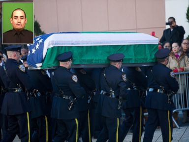 PHOTO: The casket of police officer Rafael Ramos is carried into Christ Tabernacle Church