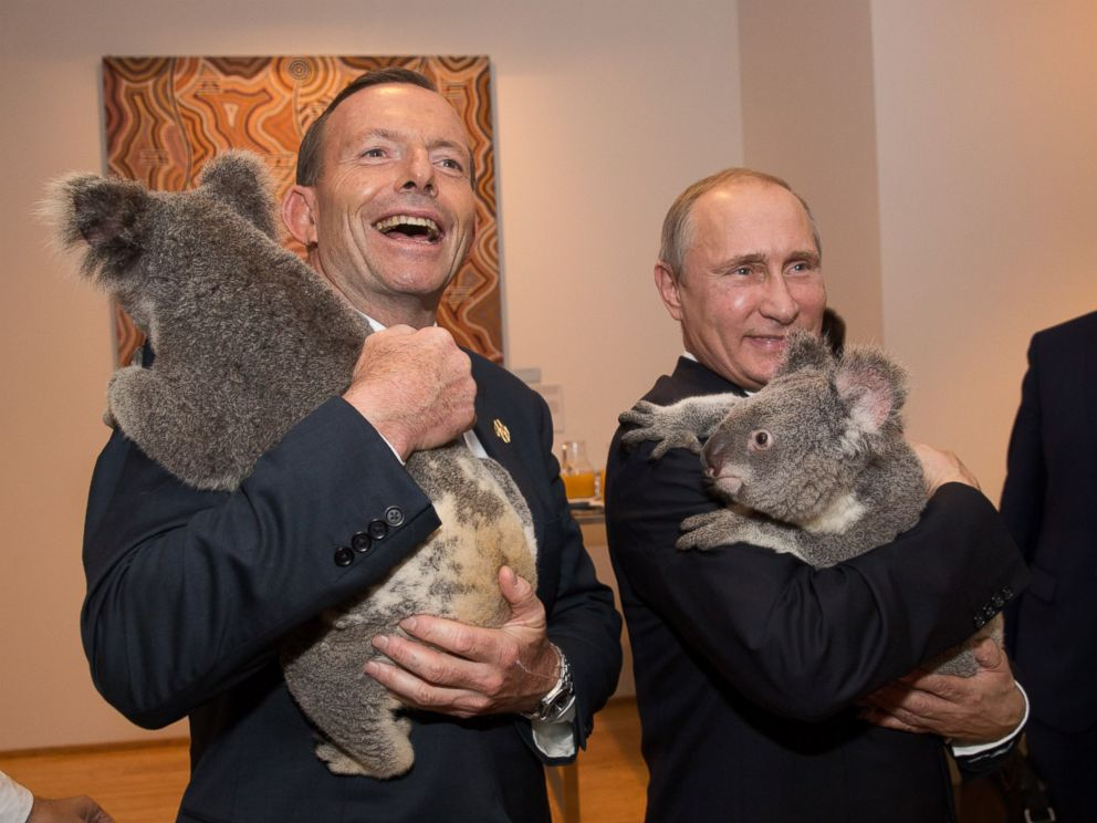 PHOTO: Australias Prime Minister Tony Abbott and Russias President Vladimir Putin