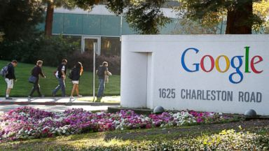 PHOTO: Employees walk past Google Inc. signage at company headquarters in Mountain View, Calif., Oct. 13, 2011.