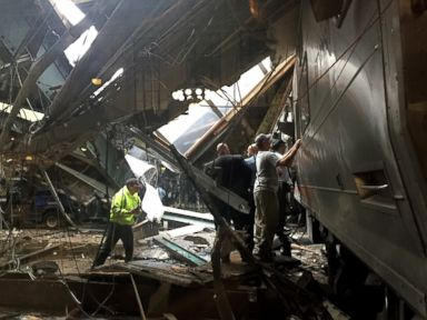 PHOTO: Train personnel survey the NJ Transit train that crashed in to the platform at the Hoboken Terminal Sept. 29, 2016 in Hoboken, New Jersey.