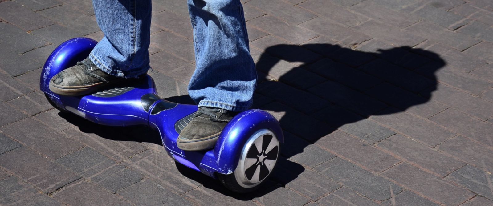 PHOTO: A boy rides his battery-operated hoverboard in Santa Fe, New Mexico on May 22, 2016.