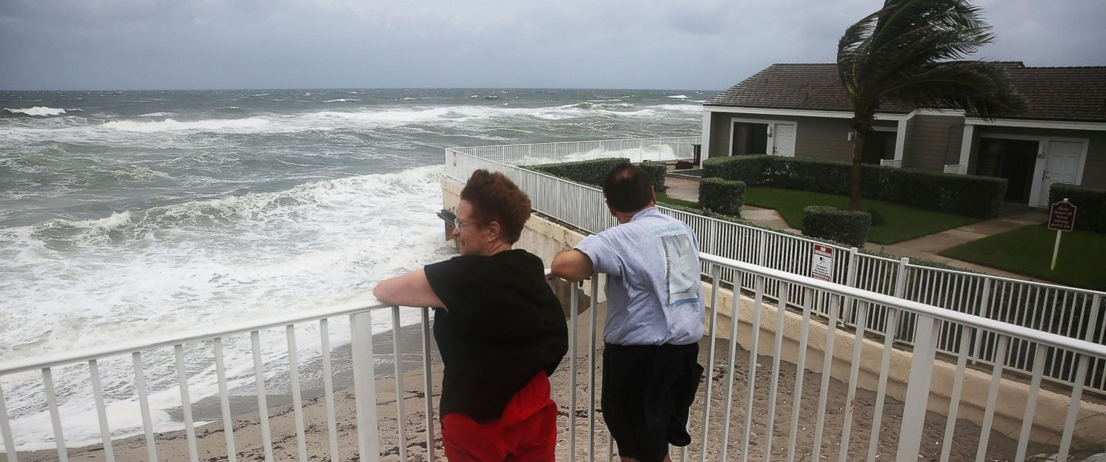 PHOTO: People look out at the churning ocean as Hurricane Matthew approaches the area, Oct. 6, 2016, in Jupiter, Florida.