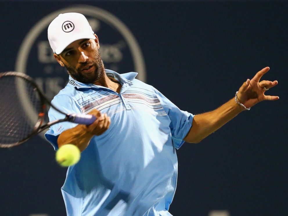 PHOTO: James Blake returns a forehand to Andy Roddick during their match as part of the Mens Legends presented by PowerShares Series on Day 4 of the Connecticut Open at Connecticut Tennis Center at Yale, Aug. 27, 2015 in New Haven, Conn.