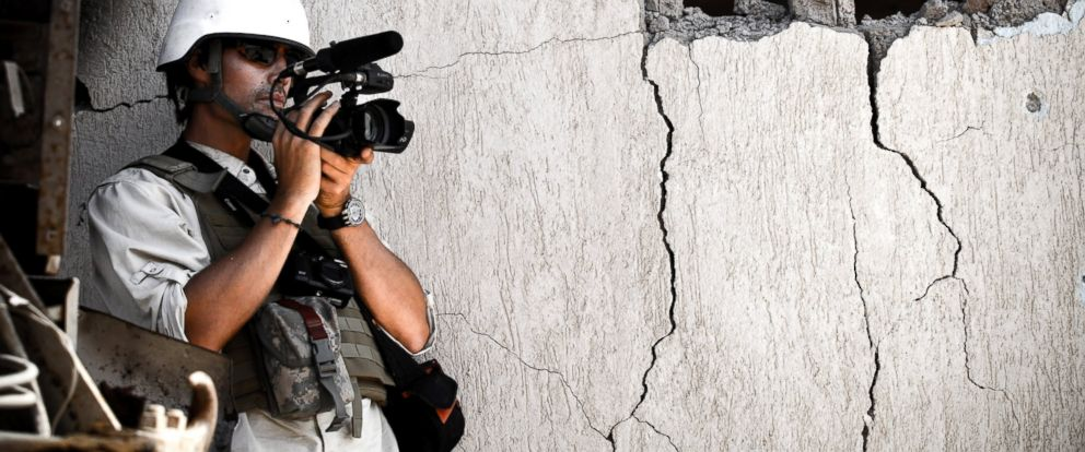 PHOTO: James Foley films Libyan NTC fighters attacking the west side of Colonel Gaddafis home city of Sirte, Oct. 05, 2011, in Libya.