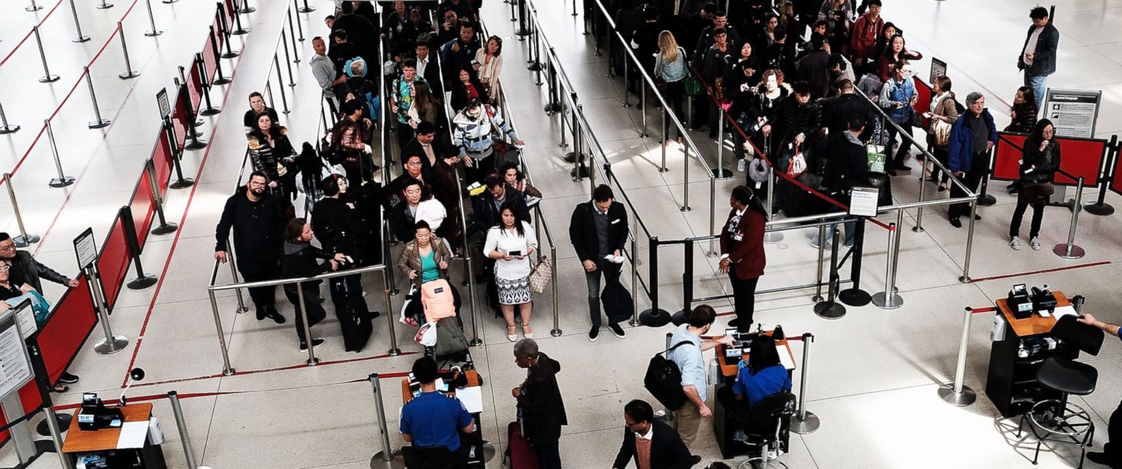 PHOTO: People wait in a security line at John F. Kennedy Airport (JFK), March 24, 2016, in New York City.