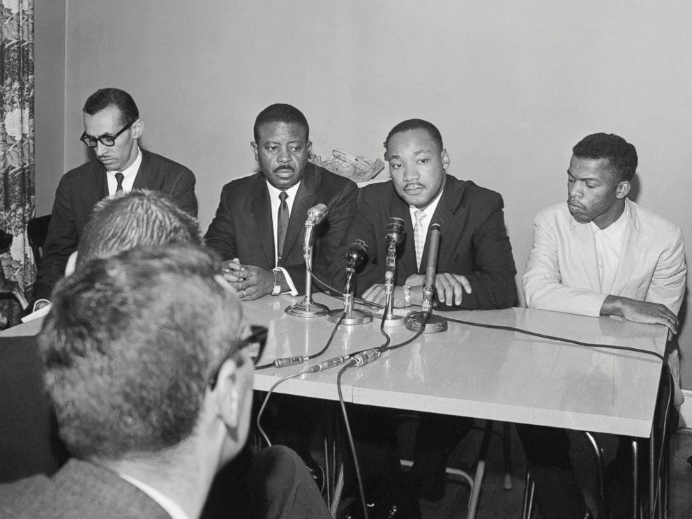 PHOTO: Leaders of the Freedom Riders, from left, Reverend Ralph Abernathy, Reverend Martin Luther King Jr., and John Lewis hold a press conference in Montgomery, Alabama.
