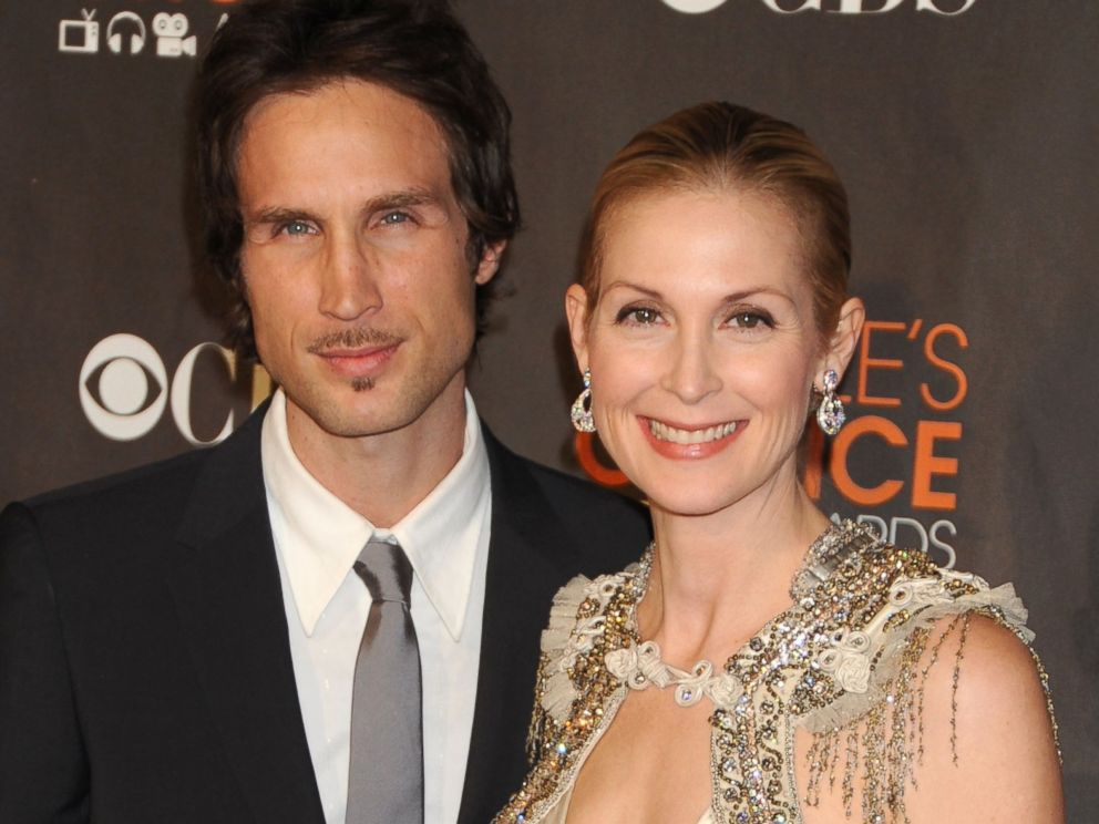 PHOTO  Kelly Rutherford  R  and husband Daniel Giersch arrives at the    Kelly Rutherford And Daniel Giersch