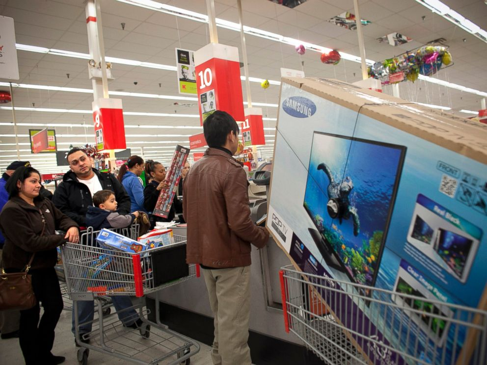 PHOTO: Shoppers wait in a check out line at a Kmart store during the Black Friday sales, Nov. 23, 2012, in Braintree, Mass.