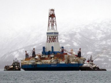 PHOTO: Salvage teams conduct an assessment of Shells Kulluk drill barge, which ran aground in 2012.