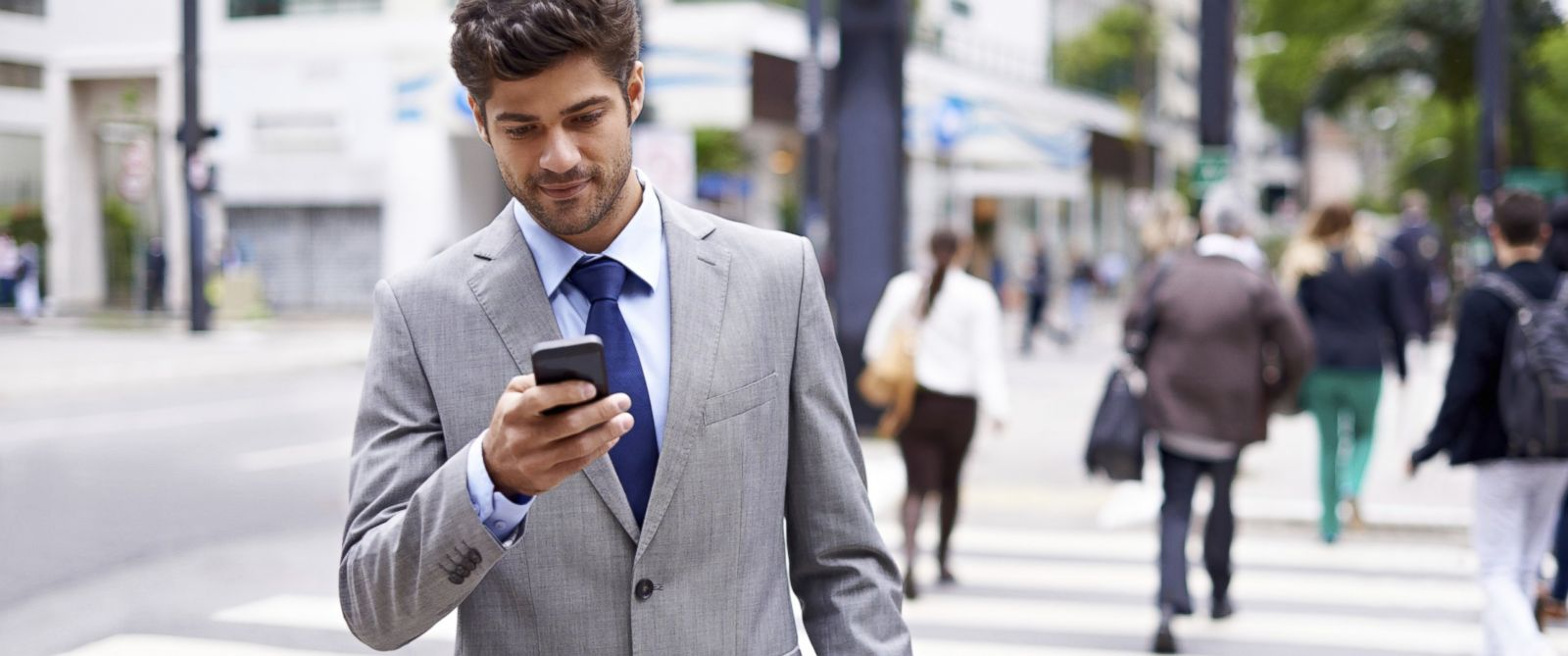 PHOTO: A young man is shown texting and walking in this undated stock photo.
