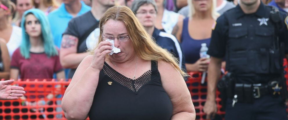 PHOTO: Melodie Gliniewicz, the wife of Fox Lake police officer Lt. Joe Gliniewicz, wipes away tears during a vigil to honor her husband, Sept. 2, 2015 in Fox Lake, Ill.