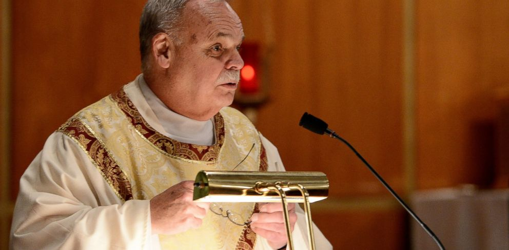 PHOTO: In this Dec. 14, 2012 photo, Monsignor Robert Weiss, of St. Rose of Lima Roman Catholic Church, celebrates mass at a vigil for victims of the Sandy Hook Elementary School shooting in Newtown, Conn.