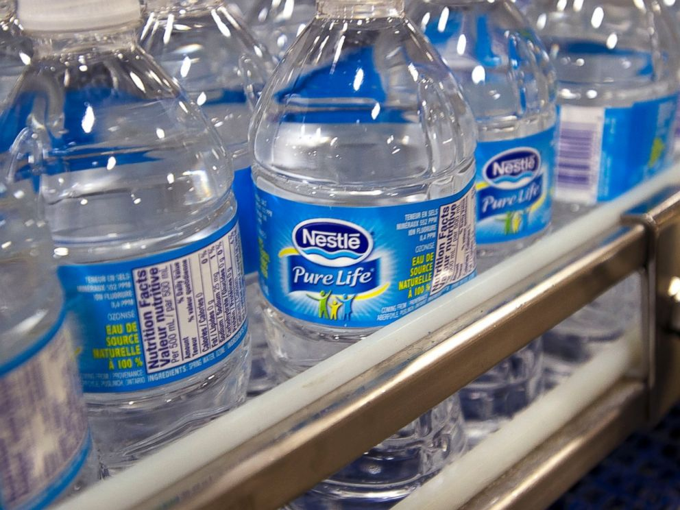 PHOTO: Bottles of Pure Life brand water are pictured on the production line at the Nestle Waters Canada plant near Guelph, Ontario, Canada on Jan. 16, 2015.