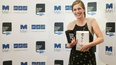 PHOTO: Eleanor Catton poses after winning the 2013 Man Booker Prize