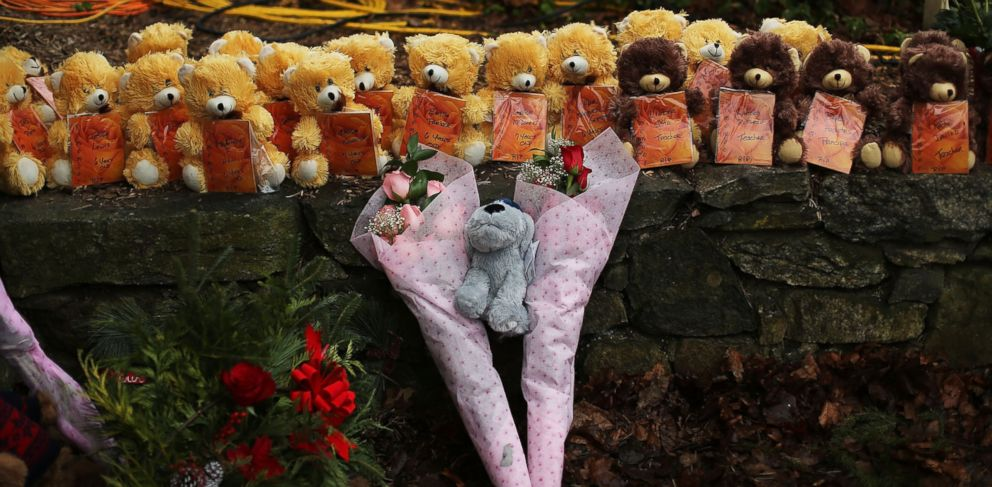 PHOTO: Teddy bears and flowers, in memory of those killed, are left at a memorial down the street from the Sandy Hook School Dec. 16, 2012 in Newtown, Conn.