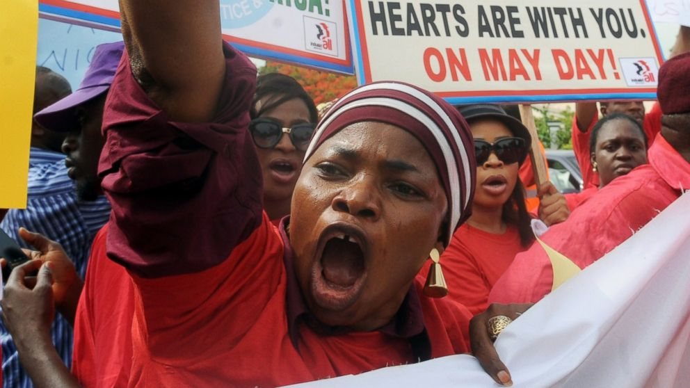PHOTO: Members of civil society groups hold placards and shout slogans as they protest the abduction of Chibok school girls during a rally pressing for the girls release in Abuja, May 6, 2014.