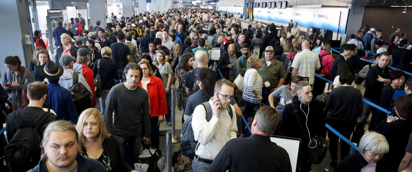 PHOTO: Passengers at OHare International Airport wait in line to be screened at a Transportation Security Administration (TSA) checkpoint, May 16, 2016, in Chicago.