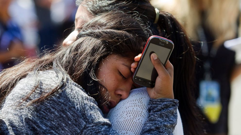 PHOTO: A Reynolds High School student is reunited with her mother after a shooting at her school June 10, 2014 in Troutdale, Oregon.