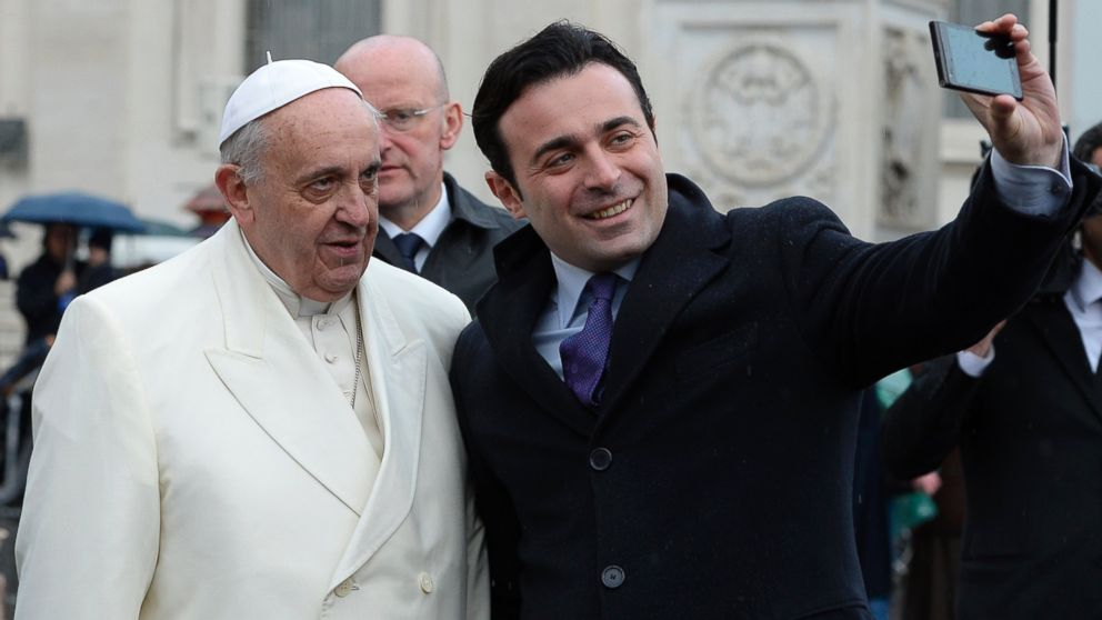 "PHOTO: Antonio Di Lucia, right, is pictured taking a ""selfie"" with Pope Francis, left, at St. Peters Square on Jan. 22, 2014 at the Vatican."