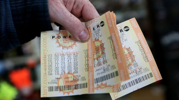 PHOTO: A customer holds a handful of Powerball tickets, Jan. 13, 2016 in San Lorenzo, Calif.