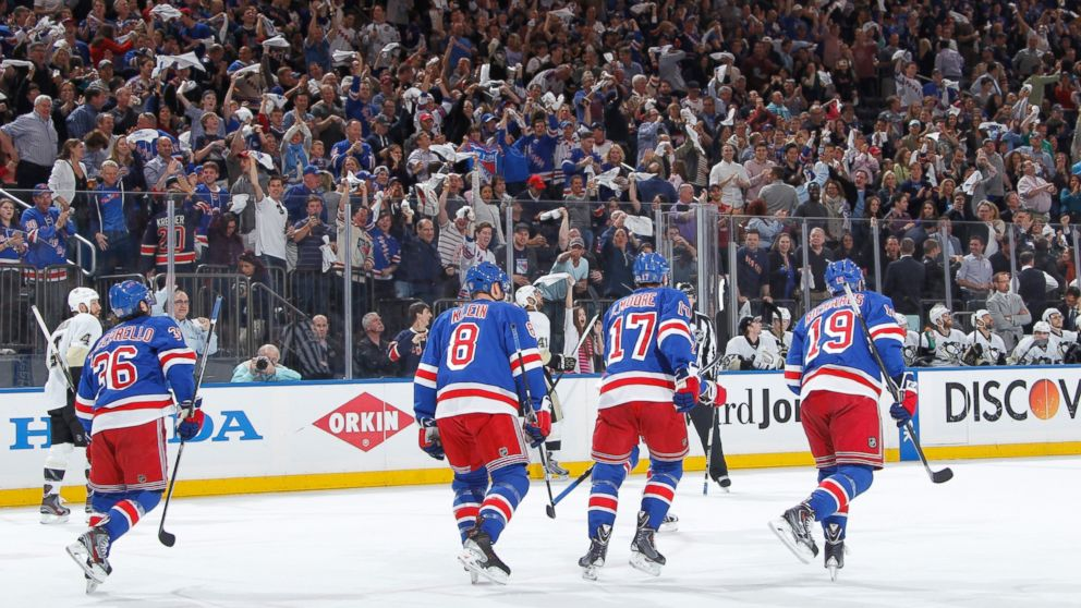 PHOTO: Fans cheer as the New York Rangers skate back the bench after a goal in the first period against the Pittsburgh Penguins in Game Six of the Second Round of the 2014 Stanley Cup Playoffs at Madison Square Garden on May 11, 2014 in New York City.