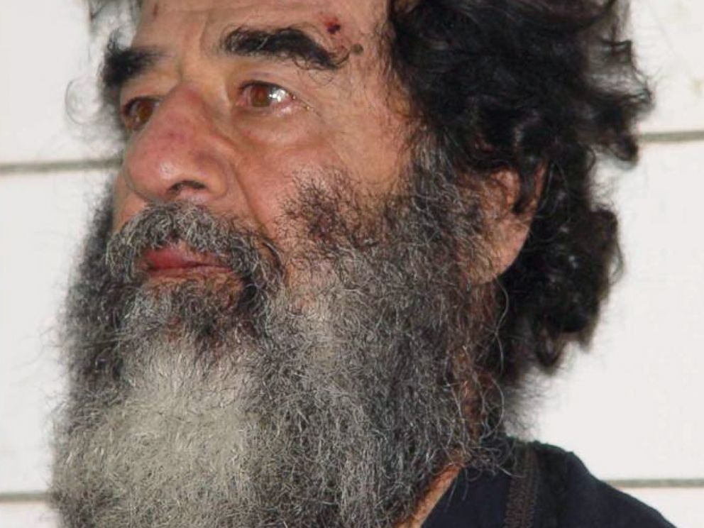 PHOTO: A handout photo of Saddam Hussein after his capture in Iraq, Dec. 14, 2003.