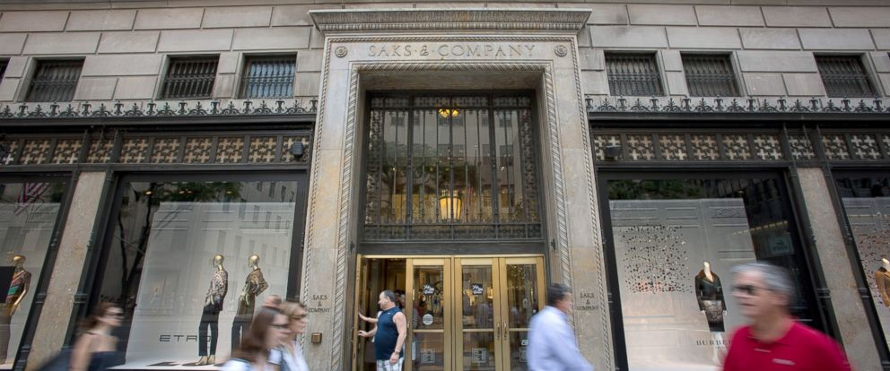PHOTO: Pedestrians pass in front of Saks Fifth Avenue in New York, July 29, 2013.