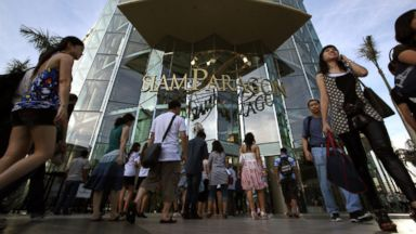 PHOTO: Shoppers pack the Siam paragon shopping mall on a busy weekend in Bangkok, Thailand