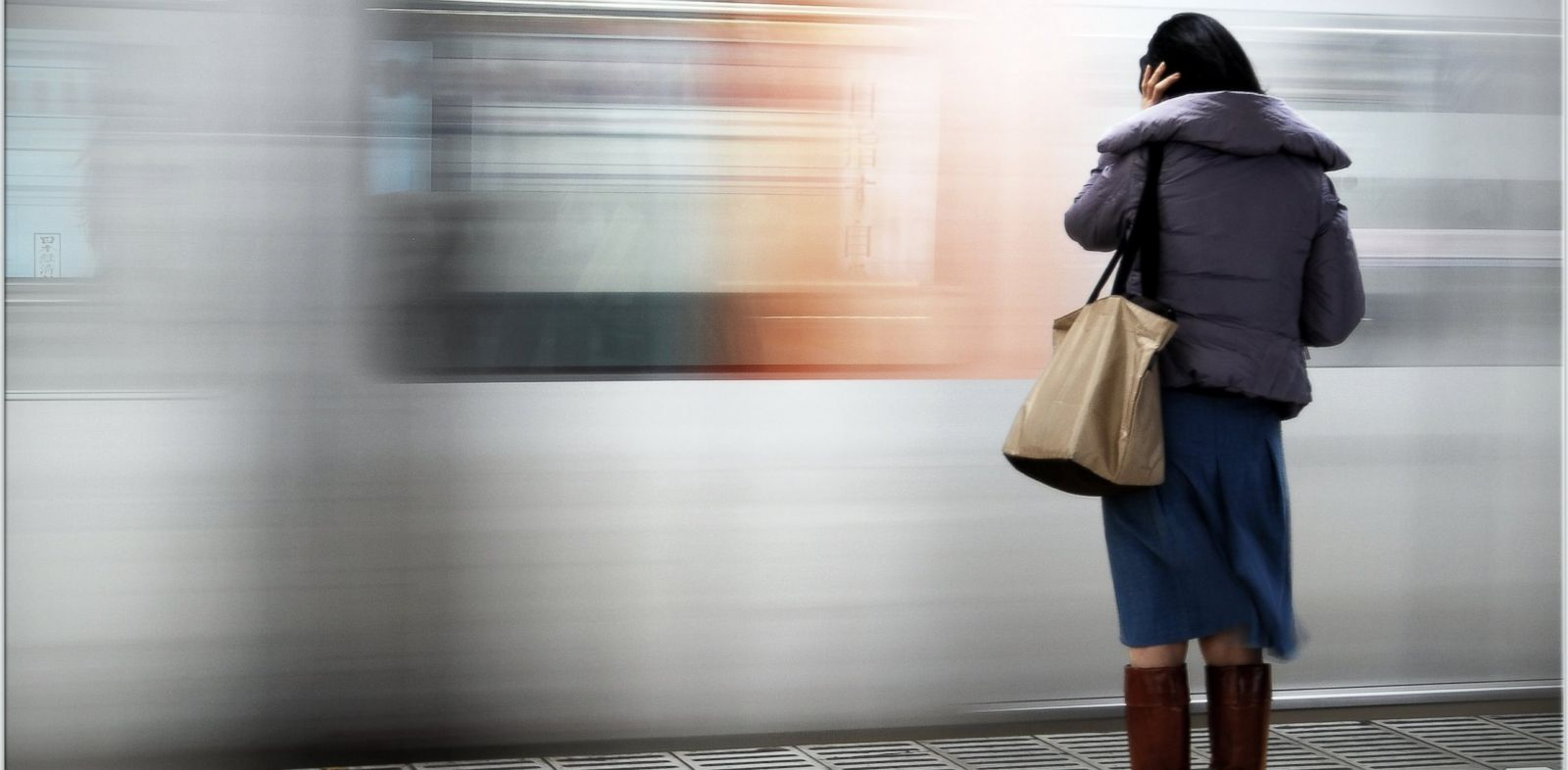 PHOTO: A woman waits for the subway.