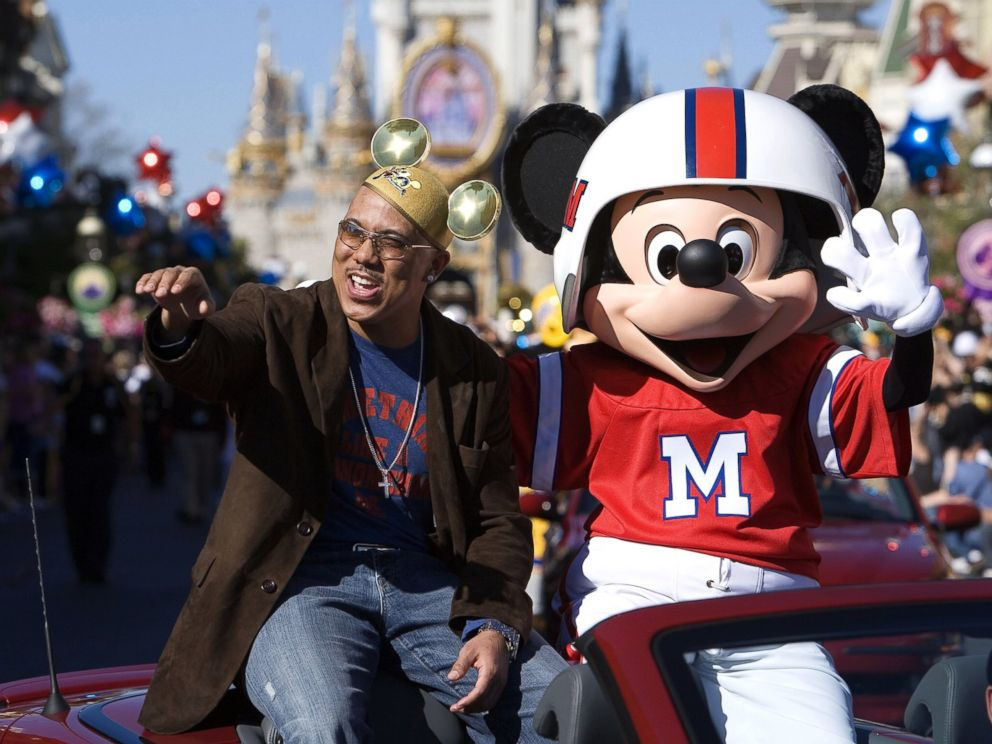 PHOTO: Super Bowl MVP Hines Ward of the Pittsburgh Steelers and Mickey Mouse wave at fans during a parade at Walt Disney Worlds Magic Kingdom, Feb. 6, 2006 in Lake Buena Vista, Fla.
