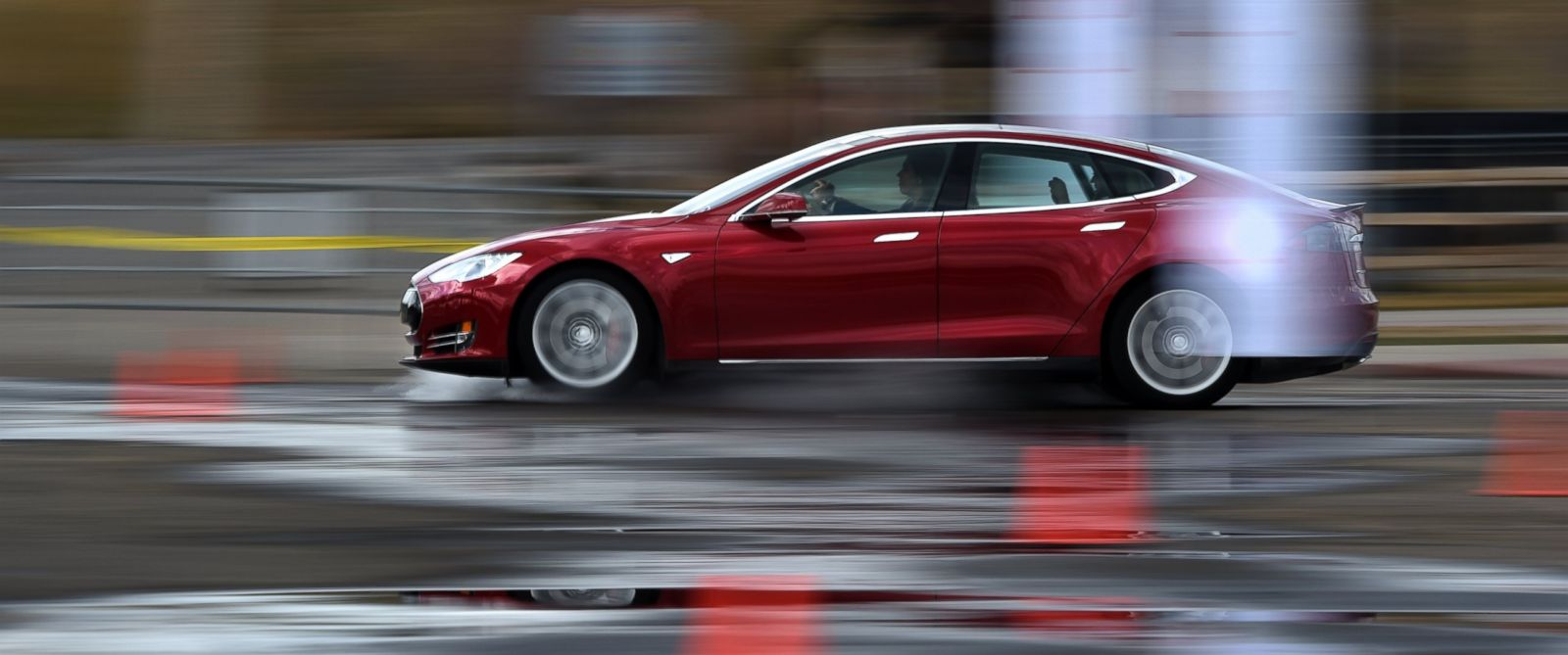 PHOTO: Clients and media were offered an opportunity to drive the Tesla Motors P85D Model S during a demonstration at Sports Authority Field in Denver, March 13, 2015.