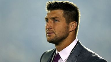 PHOTO: ESPN analyst Tim Tebow looks on during the 2014 Vizio BCS National Championship Game at the Rose Bowl, Jan. 6, 2014, in Pasadena, Calif.