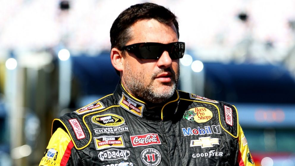PHOTO: Tony Stewart walks in the garage area during practice for the NASCAR Sprint Cup Series Quaker State 400 on June 27, 2014, in Sparta, Ky.