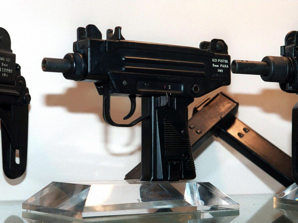 PHOTO: An Uzi pistol,center, is displayed next to the larger Uzi submachine gun models, at the Israeli Military Industries (IMI) in Ramat Hasharon, Israel, Nov. 11, 1997.