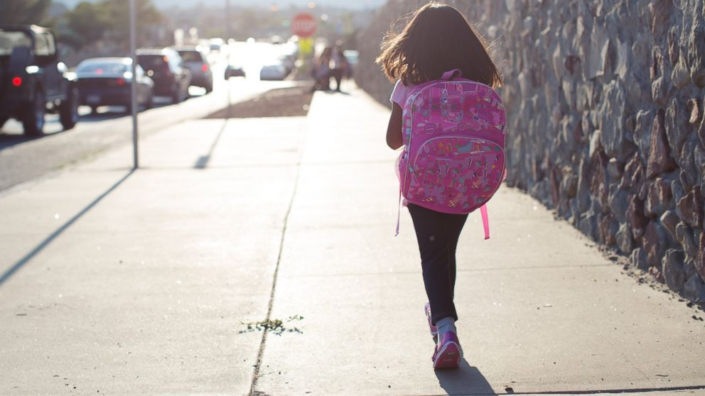 PHOTO: A girl is pictured walking to school in this stock image.
