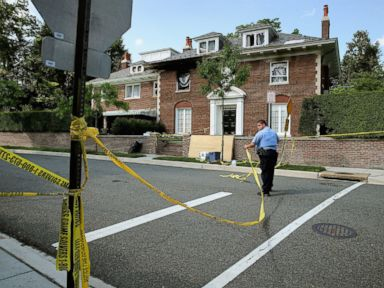 PHOTO: District of Columbia Metropolitan Police maintain a perimeter around the house on the 3200 block of Woodland Drive NW May 19, 2015 in Washington.