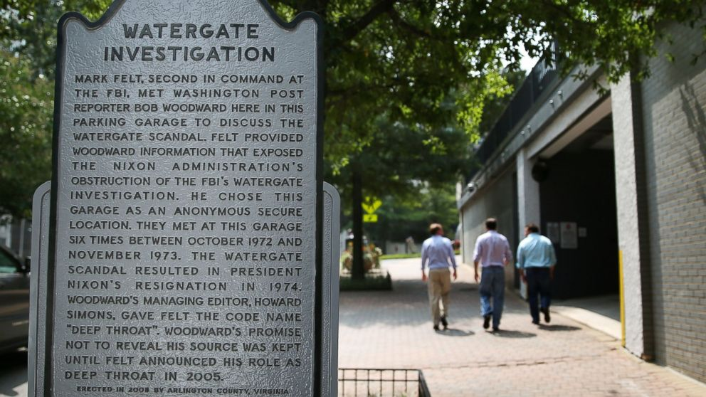 "PHOTO: People walk past the entrance of the ""Watergate garage,"" Aug. 27, 2013. in Arlington, Va."